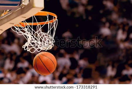 Scoring the winning points at a basketball game - stock photo