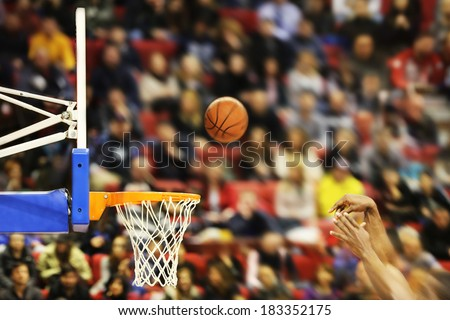 Scoring the winning points at a basketball game , motion blur - stock photo