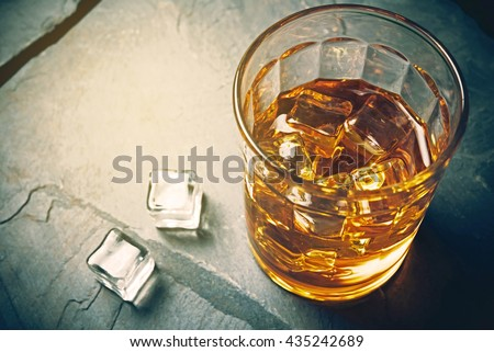 Scotch on rock background, whisky shot drinks, Alcohol shots, Scotch and alcohol, alcoholic drinks,  alcohol glasses top view, alcohol glasses of whiskey, alcoholic drink with ice on a glass. - stock photo