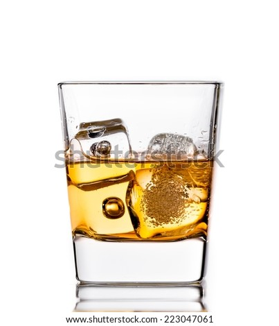 scotch whiskey in glass with ice cubes isolated on white background - stock photo