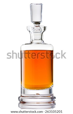 Scotch Whisky in a Crystal Glass Decanter Isolated with Reflection - stock photo
