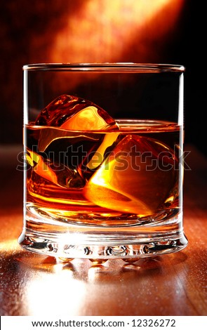scotch whisky on a table with light behind - stock photo