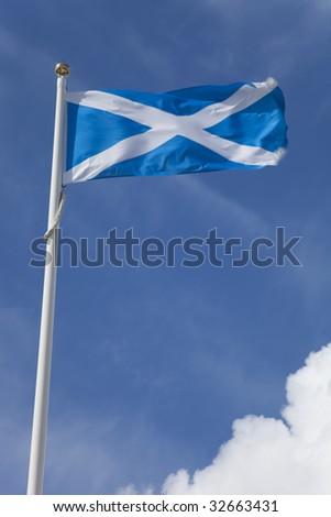Scotland Flag on Flagpole against blue sky - stock photo