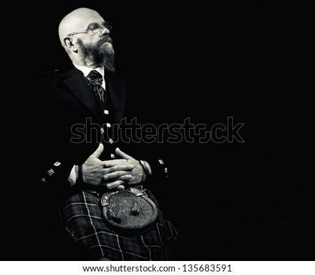 Scotsman in a kilt asleep - stock photo