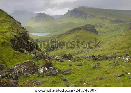 Scottish basaltic landscape in Skye isle. Quiraing. Scotland. UK. Horizontal - stock photo
