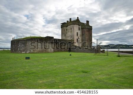 Scottish castle next to the beach  - stock photo