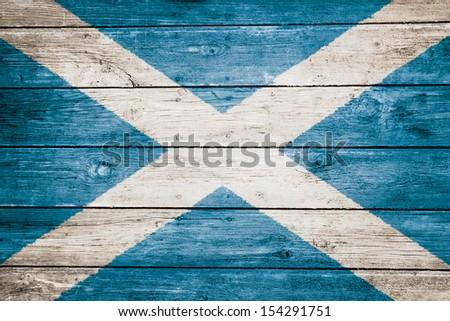scottish flag on wood texture background - stock photo