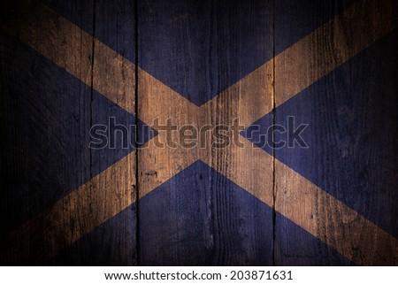 Scottish flag over a grunge wooden background. - stock photo