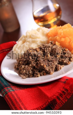 Scottish Haggis Table Setting For A Burns Night Dinner With A Royal Stuart Tartan Napkin - stock photo