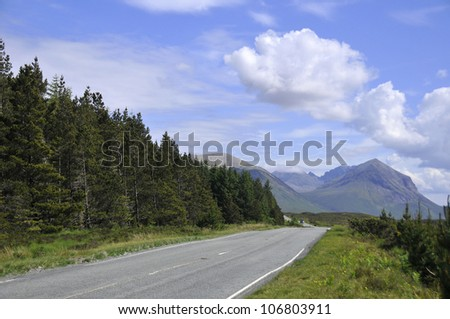 Scottish landscape with forest, roads and hills - stock photo