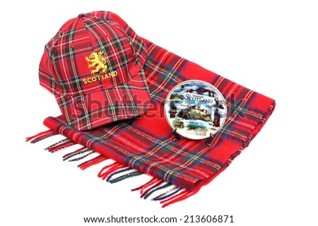 Scottish Red tartan cap, tartan scarves and souvenir plate Isolated on White - stock photo