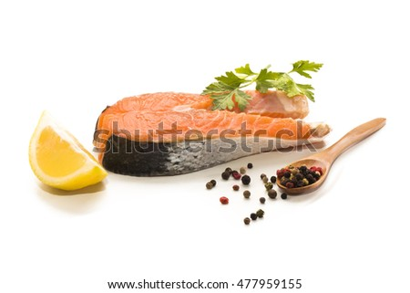 scottish salmon steak with lemon, parsley and peppercorn on white background