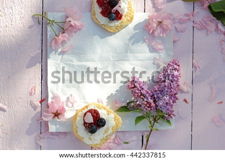 Scottish scones with cream, jam and blueberries close up background