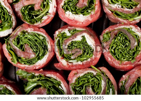 scottona veal rolls with cheese and rocket - stock photo
