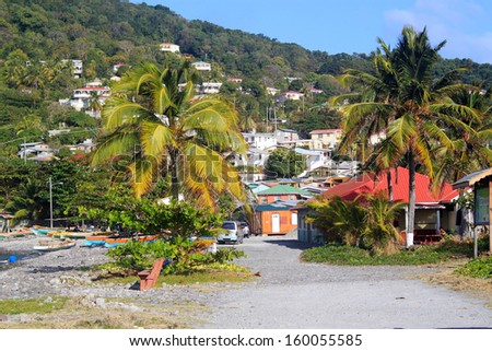 Scotts Head fishing village in Dominica, Caribbean Islands It's the meeting point of Atlantic Ocean and Caribbean Sea (Soufriere Bay) and famous of snorkeling and diving places.  - stock photo