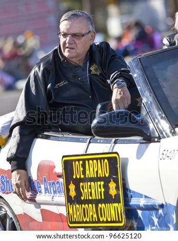 SCOTTSDALE, AZ - FEBRUARY 11: Maricopa County Arizona sheriff Joe Arpaio rides in the Scottsdale Parada Del Sol on February 11, 2012 in Scottsdale, AZ. - stock photo