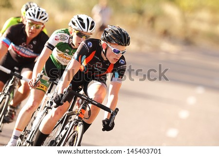 SCOTTSDALE, AZ - MAY 19: Austin Crosby competes in the Criterium at DC Ranch, a high-speed circuit race on a 1-kilometer closed course on May 19, 2013 in Scottsdale, AZ.  - stock photo