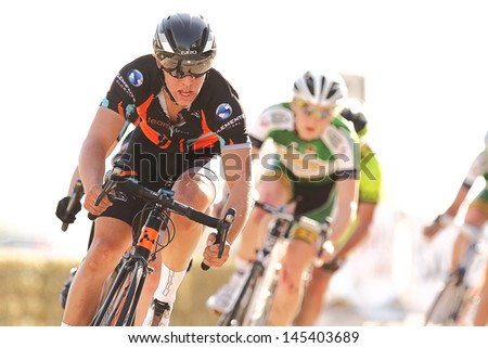 SCOTTSDALE, AZ - MAY 19: Domenic Suozzi leads the pack during the Criterium at DC Ranch, a high-speed circuit race on a 1-kilometer closed course on May 19, 2013 in Scottsdale, AZ.