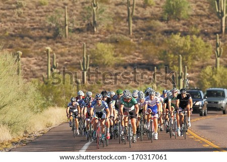 SCOTTSDALE, AZ - OCTOBER 14: Cyclists compete in the 9th annual Tour de Scottsdale, a 70-mile charity bicycle race benefiting the McDowell Sonoran Conservancy in Scottsdale, AZ on October 14, 2012. - stock photo