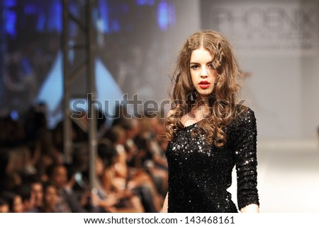 SCOTTSDALE, AZ - OCTOBER 8: Models showcasing designs during a runway fashion show at the Phoenix Fashion Week on October 8, 2011 in Scottsdale, Arizona.