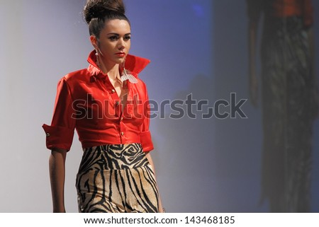 SCOTTSDALE, AZ - OCTOBER 8: Models showcasing designs during a runway fashion show at the Phoenix Fashion Week on October 8, 2011 in Scottsdale, Arizona. - stock photo