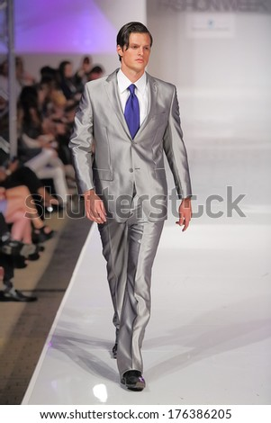 SCOTTSDALE, AZ - OCTOBER 5: Models showcasing designs from Jean Paul Jeune during a runway show at the Phoenix Fashion Week on October 5, 2012  in Scottsdale, Arizona. - stock photo