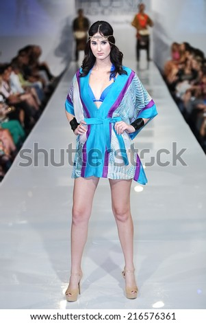 SCOTTSDALE, AZ - OCTOBER 3: Models showcasing designs from the Dolcessa swimwear collection during a runway show at the Phoenix Fashion Week at Talking Stick Resort on Oct. 3, 2013 in Scottsdale, AZ.  - stock photo