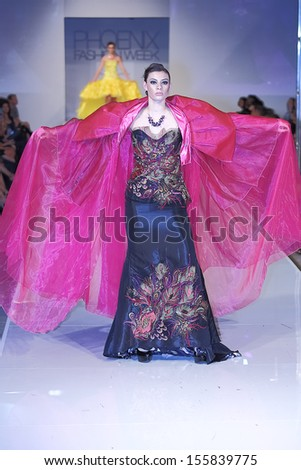 SCOTTSDALE, AZ - OCTOBER 6: Models showcasing designs from the Italia Rocks Couture collection during a runway show at the Phoenix Fashion Week on October 6, 2012 in Scottsdale, Arizona.  - stock photo