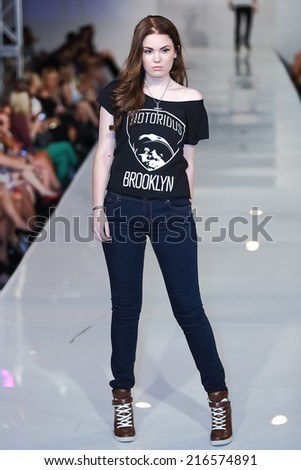 SCOTTSDALE, AZ - OCTOBER 3: Models showcasing designs from the Medium Apparel collection during a runway show at the Phoenix Fashion Week at Talking Stick Resort on October 3, 2013 in Scottsdale, AZ.  - stock photo