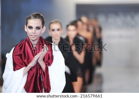SCOTTSDALE, AZ - OCTOBER 3: Models showcasing designs from the Shawl Dawls collection during a runway show at the Phoenix Fashion Week at Talking Stick Resort on October 3, 2013 in Scottsdale, AZ  - stock photo