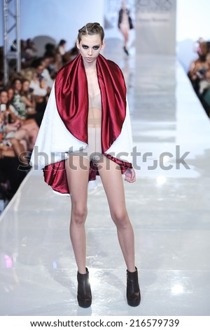 SCOTTSDALE, AZ - OCTOBER 3: Models showcasing designs from the Shawl Dawls collection during a runway show at the Phoenix Fashion Week at Talking Stick Resort on October 3, 2013 in Scottsdale, AZ.  - stock photo