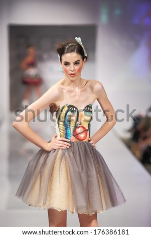 SCOTTSDALE, AZ - OCTOBER 5: Models showcasing designs from the Silvia Bours collection during a runway show at the Phoenix Fashion Week on October 5, 2012  in Scottsdale, Arizona. - stock photo