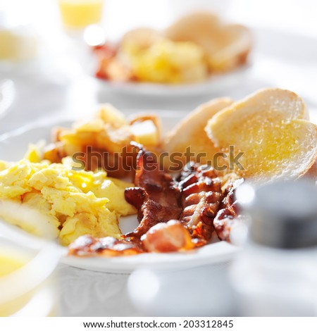 scrambled eggs and bacon breakfast meal - stock photo
