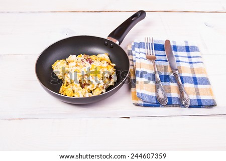 scrambled eggs in a frying pan - stock photo