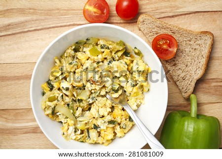 scrambled eggs with fresh vegetables - stock photo