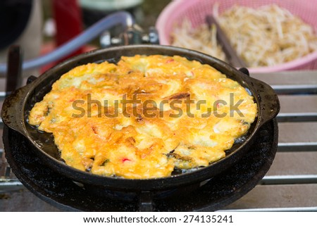 Scrambled eggs with fried bacon and toast - stock photo