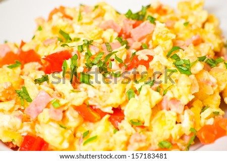 scrambled eggs with ham and vegetables - stock photo
