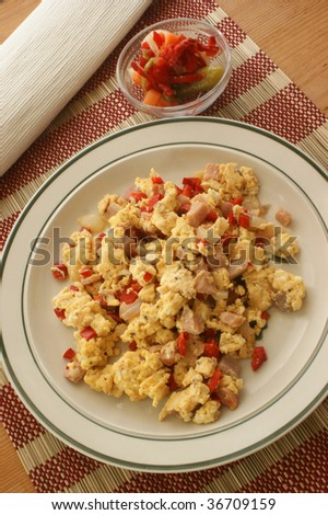 scrambled eggs with organic tomato and bacon