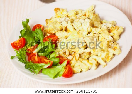 scrambled eggs with salad - stock photo