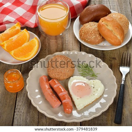 Scrambled eggs with sausage for breakfast - stock photo