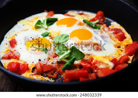 scrambled eggs with tomatoes - stock photo