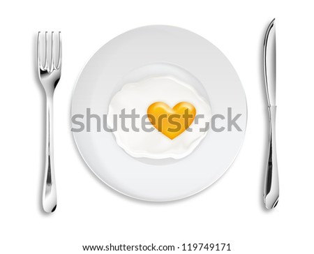 scrambled in the form of heart on a plate - stock photo