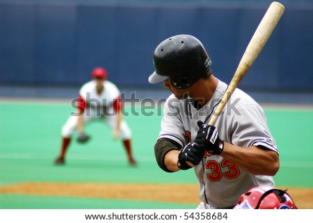 SCRANTON - JULY 31: Rochester Red Wings batter, Garrett Jones watches a pitch  against the Scranton Wilkes Barre Red Barons in a game at PNC Field July 31, 2005 in Scranton, PA. - stock photo