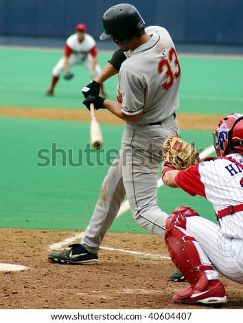 SCRANTON - JULY 31:  Rochester Red Wings batter takes a swing against the Scranton Wilkes Barre Red Barons in a game at PNC Field July 31, 2005 in Scranton, PA. - stock photo