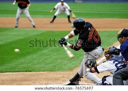 SCRANTON - JULY 31: Rochester Red Wings' Jose Morales  (No. 17) swings at a pitch in a game against the Scranton Wilkes Barre Yankees at PNC Field on July 31, 2008 in Scranton, PA. - stock photo