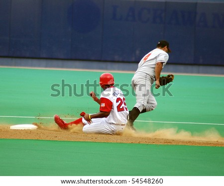 SCRANTON - JULY 31:, Scranton Wilkes Barre Red Barons runner slides into second base in a game against the Rochester Red Wingsat PNC Field July 31, 2005 in Scranton, PA. - stock photo