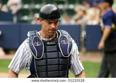 SCRANTON - JULY 31: Scranton Wilkes Barre Yankees catcher Chris Stewart walks off the field in a game at PNC Field July 31, 2008 in Scranton, PA. - stock photo