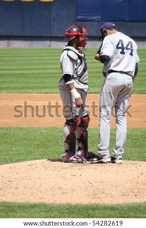 SCRANTON - MAY 13:  Columbus Clippers Jeanmar Gomez and catcher  Carlos Santana have a discussion on the mound against the Scranton Wilkes Barre Yankees at PNC Field May 13, 2010 in Scranton, PA - stock photo