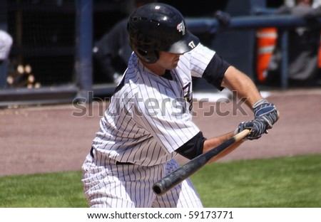 SCRANTON - May 13: Scranton Wilkes Barre Yankees batter checks his swing against Columbus Clippers in a game at PNC Field May 13, 2010 in Scranton, PA - stock photo