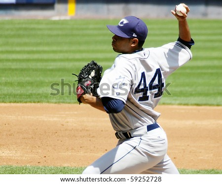 SCRANTON - MAY 13: The Columbus Clippers pitcher Jeanmar Gomez fires a pitch in a game against Scranton Wilkes Barre Yankees in a game at PNC Field May 13, 2010 in Scranton, PA - stock photo